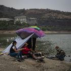A family has lunch under a tent on the banks of the Madin Dam.  Currently, Mexico City has a demand of 480 billion liters of water per year.