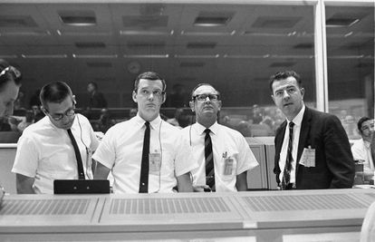 NASA mission control observes the flight of the Gemini-10 mission in July 1966. Glynn Lunney is second from left.