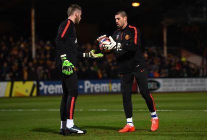 Valdés, junto a De Gea