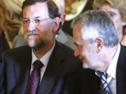 Rajoy y Griñán, en Sevilla el pasado año.