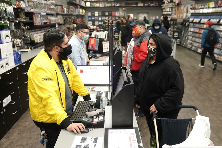 Inside a GameStop store people line up to purchase a Sony PS5 gaming console in the Manhattan borough of New York City, New York, U.S., November 12, 2020. REUTERS/Carlo Allegri