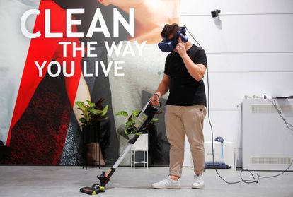 A man with VR glasses tests a Hoover vacuum cleaner at the IFA consumer electronics fair in Berlin, Germany, September 4, 2019. REUTERS/Hannibal Hanschke