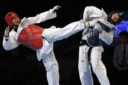 Briseis Acosta se enfrenta a la rusa Olga Ivanova en taekwondo mundial en 2013.