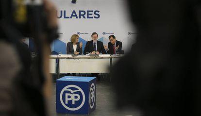 Rajoy, Cospedal y Maillo, este lunes en un acto del PP.