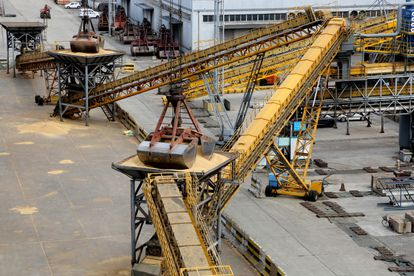 A system of cranes unloads tons of soybeans imported from Brazil in the Chinese port of Lianyungang,