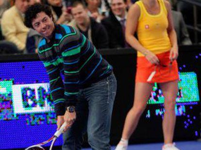 McIlroy, y tras él Wozniacki, en el Madison Square Garden.