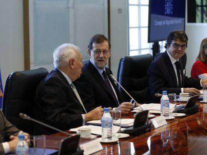 Montoro, Margallo, Rajoy y Moragas, este viernes.