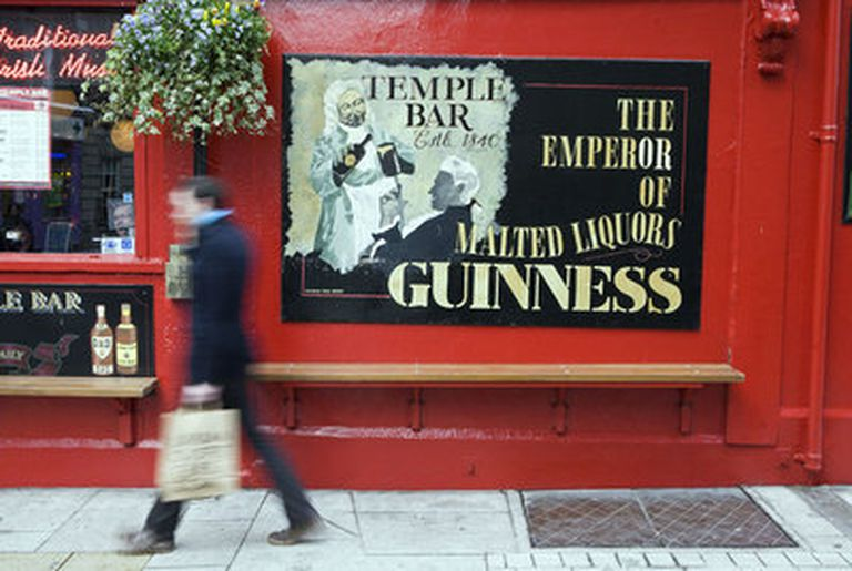 A man walks past The Temple Bar pub in Dublin in mid-October.