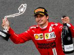 Second-placed Ferrari's Spanish driver Carlos Sainz Jr celebrates during the podium ceremony after the Monaco Formula 1 Grand Prix at the Monaco street circuit in Monaco, on May 23, 2021. (Photo by GONZALO FUENTES / POOL / AFP)