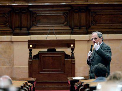 El presidente de la Generalitat, Quim Torra, interviene en el pleno del Parlament.