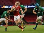 Wales George North runs on his way to score a try during the Six Nations rugby union international between Wales and Ireland at the Principality Stadium in Cardiff, Wales, Sunday, Feb. 7, 2021. (AP Photo/Rui Vieira)