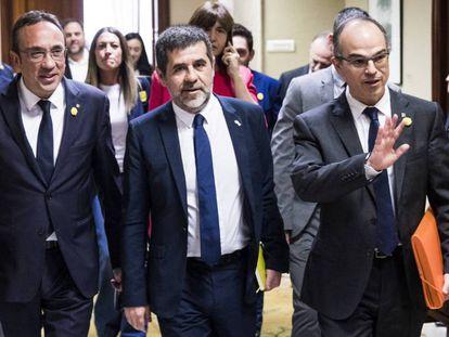 Josep Rull, Jordi Sànchez y Jordi Turull, en mayo a la salida del registro del Congreso.