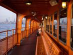 A commuter enjoys the sunset alone on the upper deck of a Staten Island Ferry during the outbreak of the coronavirus disease (COVID-19) in Manhattan, New York City, U.S., March 26, 2020.