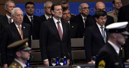 Mariano Rajoy, y el ministro de Exteriores, José Manuel Garcia-Margallo, en la cumbre de la OTAN celebrada en Chicago.