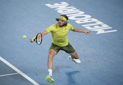 Greece's Stefanos Tsitsipas hits a backhand return to Spain's Rafael Nadal during their quarterfinal match at the Australian Open tennis championship in Melbourne, Australia, Wednesday, Feb. 17, 2021.(AP Photo/Andy Brownbill)