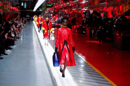 Models present outfits from luxury carmaker Ferrari's first internally-designed fashion collection for women and men as the first step of its rebooted brand extension strategy, in Maranello, Italy, June 13, 2021. Picture taken June 13, 2021. REUTERS/Remo Casilli