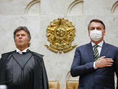 El presidente del Supremo Tribunal de Brasil, el magistrado Luiz Fux, junto al presidente de Brasil, Jair Bolsonaro, el pasado febrero.