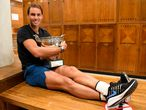 """A handout photograph taken and released on October 11, 2020 by the Federation Francaise de Tennis (FFT) shows Spain's Rafael Nadal posing with The Mousquetaires Cup - The Musketeers in the locker room after winning the men's singles final tennis match against Serbia's Novak Djokovic at the Philippe Chatrier court, on Day 15 of The Roland Garros 2020 French Open tennis tournament in Paris. (Photo by Julien Crosnier / FFT - FEDERATION FRANCAISE DE TENNIS / AFP) / RESTRICTED TO EDITORIAL USE - MANDATORY CREDIT """"AFP PHOTO / FEDERATION FRANCAISE DE TENNIS (FFT) / JULIEN CROSNIER """" - NO MARKETING - NO ADVERTISING CAMPAIGNS - DISTRIBUTED AS A SERVICE TO CLIENTS"""
