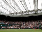 Belarus's Aryna Sabalenka (L) throws the ball to serve against Tunisia's Ons Jabeur during their women's quarter-final tennis match under the closed roof of Centre Court on the eighth day of the 2021 Wimbledon Championships at The All England Tennis Club in Wimbledon, southwest London, on July 6, 2021. (Photo by Adrian DENNIS / AFP) / RESTRICTED TO EDITORIAL USE