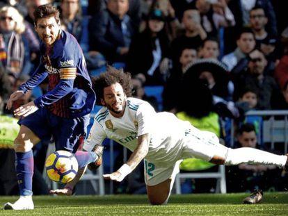 Leo Messi y Marcelo en el último clásico disputado en el Bernabéu.
