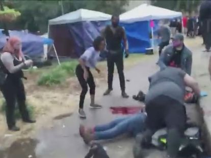 SENSITIVE MATERIAL. THIS IMAGE MAY OFFEND OR DISTURB People come to the aid of a victim bleeding on the ground after a fatal shooting at Jefferson Square Park, in Louisville, Kentucky, U.S., June 27, 2020 in this still image obtained from social media video. Protesters have camped out at the park to demonstrate against the police killing of Breonna Taylor, a Black woman, in her home in March. Content filmed June 27, 2020. Maxwell Mitchell via REUTERS THIS IMAGE HAS BEEN SUPPLIED BY A THIRD PARTY. MANDATORY CREDIT