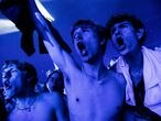 """People react during a concert by a Danish band """"The Minds of 99"""" amid the coronavirus disease (COVID-19) outbreak, in Copenhagen's Parken stadium, Denmark, September 11, 2021. Picture taken September 11, 2021. Ritzau Scanpix/Olafur Steinar Gestsson via REUTERS THIS IMAGE HAS BEEN SUPPLIED BY A THIRD PARTY. DENMARK OUT. NO COMMERCIAL OR EDITORIAL SALES IN DENMARK"""
