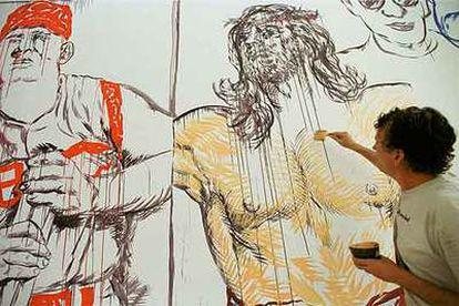 Raymond Pettibon, pintando uno de sus murales.