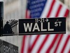 FILE PHOTO: The Wall Street sign is pictured at the New York Stock exchange (NYSE) in the Manhattan borough of New York City, New York, U.S., March 9, 2020. REUTERS/Carlo Allegri/File Photo/File Photo