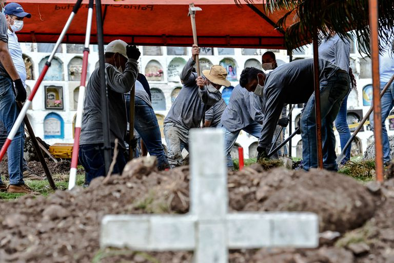 Gravediggers and forensic experts search for the remains of victims executed by members of the Colombian Army during the armed conflict, in the Dabeiba cemetery, Antioquia, Colombia, on November 10.
