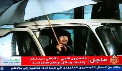 Imagen de la cadena Al Arabiya del breve discurso del dictador libio.