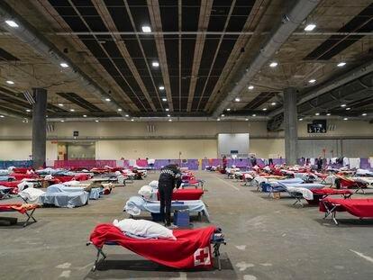 Pabellón 14 de Ifema, convertido en albergue de emergencia para 150 personas sin hogar.