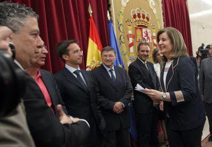 La ministra de Empleo, Fátima Báñez, durante el acto en el que el comité de expertos ha hecho público el informe sobre sostenibilidad de las pensiones