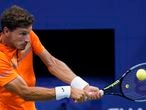 Pablo Carreno Busta, of Spain, returns to Denis Shapovalov, of Canada, during the quarterfinal round of the US Open tennis championships, Tuesday, Sept. 8, 2020, in New York. (AP Photo/Frank Franklin II)