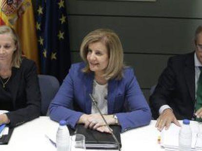 La ministra Fátima Báñez preside la conferencia, este martes.