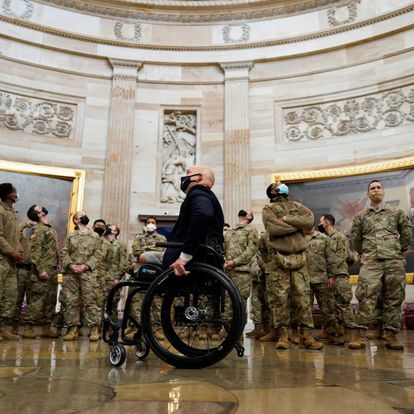 U.S. Rep. Brian Mast (R-FL) leads a tour for members of the National Guard as Democrats debate one article of impeachment against U.S. President Donald Trump at the U.S. Capitol, in Washington, U.S., January 13, 2021. REUTERS/Joshua Roberts