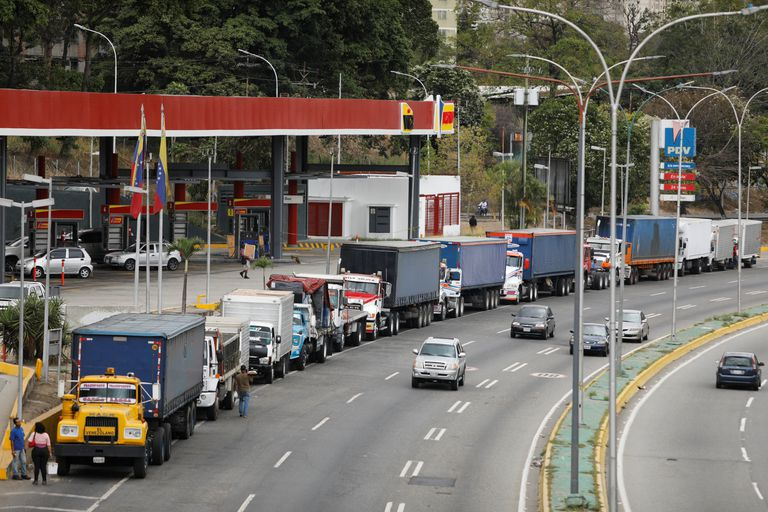 Trucks line up along an avenue to fill their tanks at a gas station as part of a growing diesel shortage in Caracas, Venezuela, on March 5.
