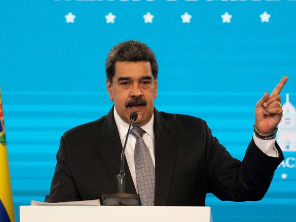 Venezuelan President Nicolas Maduro, gestures while speaking during a press conference at the Miraflores presidential palace in Caracas on February 17, 2021. - Venezuela will kick off its vaccination campaign against covid-19 this Thursday, following the arrival of the first 100,000 of 10 million doses of Russian Sputnik V vaccines, with health personnel and government authorities in the first phase, President Nicolas Maduro said. (Photo by Yuri CORTEZ / AFP)