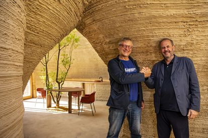 The architect together with a representative of the company WASP, specialized in 3-D printing, inside the house