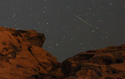 A Perseid meteorite passes over a sandstone outcrop at Redstone in the Pinto Valley Wilderness Area in Lake Mead National Recreation Area, Nevada.