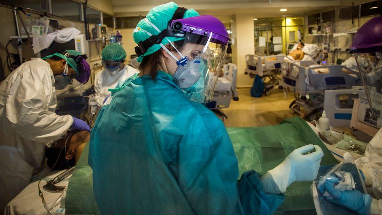 Health personnel attend to a patient in an improvised ICU, at the Hospital de La Paz, in Madrid, last April.