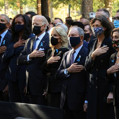 From left, former President Bill Clinton, former First Lady Hillary Clinton, former President Barack Obama, former First Lady Michelle Obama, President Joe Bien, First Lady Jill Biden, former New York City Mayor Michael Bloomberg, Bloomberg's partner Diana Taylor, Speaker of the House Nancy Pelosi (D-CA) and Senate Minority Leader Charles Schumer (D-NY) stand for the national anthem during the annual 9/11 Commemoration Ceremony at the National 9/11 Memorial and Museum on Saturday, Sept. 11, 2021 in New York. (Chip Somodevilla/Pool Photo via AP)