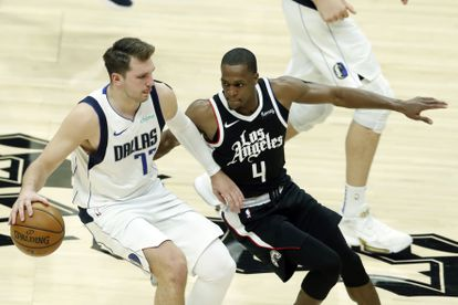 Doncic, with the ball, against Rondo during the Dallas-Clippers.