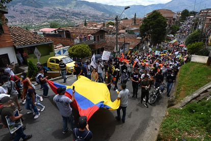 People take part in a new protest against the government of Colombian President Ivan Duque, in Medellin, Colombia, on May 12, 2021. (Photo by Joaquin SARMIENTO / AFP)