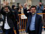 Jordi Cuixart (L), leader of Omnium Cultural, and Jordi Sanchez of the Catalan National Assembly (ANC), arrive to the High Court in Madrid