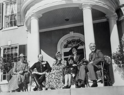 (Original Caption) Hyde Park, New York: Norwegian Royalty Guests Of President Roosevelt. Mrs. Roosevelt, Crown Prince Olav of Norway, Sara Delano Roosevelt, the President's mother; Crown Princess Martha and President Roosevelt, (from left to right), are shown seated on a porch of the Roosevelt home at Hyde Park, April 30th, as the Norwegian Royalty were guests of the President and First Lady.