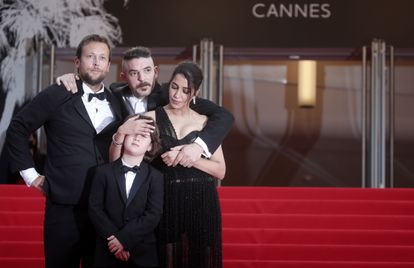 The cast of 'The Restless' on the Cannes red carpet: director Joachim Lafosse and actors Damien Bonnard, Leila Bekhti and Gabriel Merz Chammah (the child).