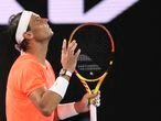 Spain's Rafael Nadal reacts after losing a point against Greece's Stefanos Tsitsipas during their quarterfinal match at the Australian Open tennis championship in Melbourne, Australia, Wednesday, Feb. 17, 2021.(AP Photo/Hamish Blair)