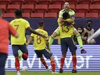Colombia's goalkeeper David Ospina, above, and teammate Yerry Mina, below right, celebrate after defeating Uruguay 4-2 in a penalty shootout during a Copa America quarterfinal soccer match at the National stadium in Brasilia, Brazil, Saturday, July 3, 2021. (AP Photo/Bruna Prado)