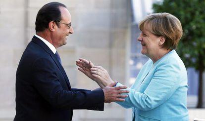 Merkel y Hollande, el 6 de julio en París.