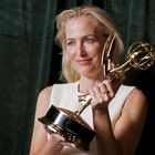 """Gillian Anderson poses with her Emmy award for Outstanding Supporting Actress in a Drama Series, backstage at the Netflix UK Primetime Emmy for """"The Crown"""", in London, Britain, September 20, 2021. REUTERS/Peter Nicholls"""